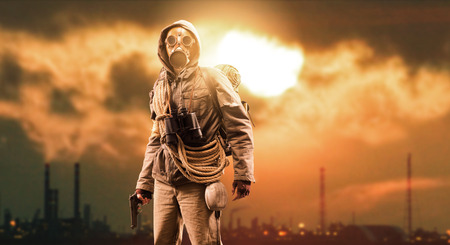 Brave post apocalyptic survivor with gas mask and a gun; polluting industries, toxic smog hiding the sun and environmental degradation in the background