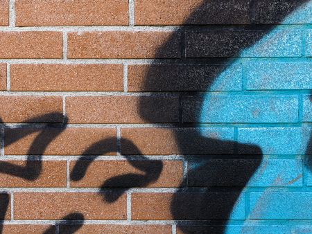 Creative street art graffiti on a brick wall: colorful abstract design close up