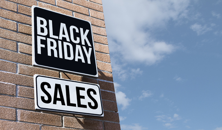 Black friday sales on a street sign: promotional event and marketing concept