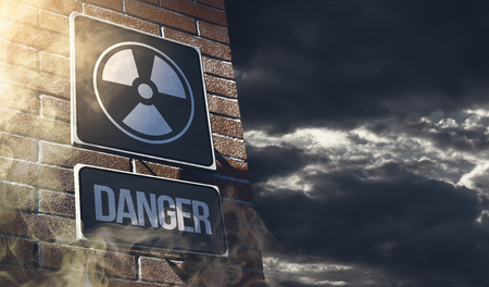 Radioactivity and chemical hazard street sign with toxic clouds on the background: pollution and danger concept Stock Photo