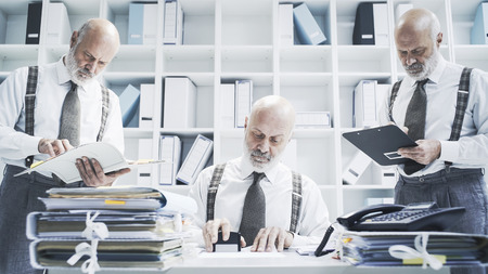 Businessman working on different tasks at the same time: efficiency and flexibility concept Stock Photo