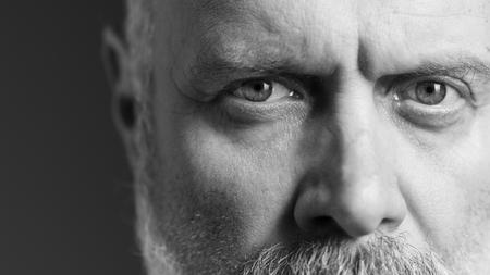 Black and white portrait of a confident mature man, close up Standard-Bild - 116701793