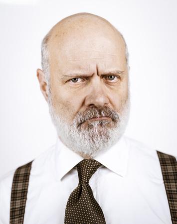 Disappointed sad senior man posing on white background, headshot Standard-Bild - 116681690