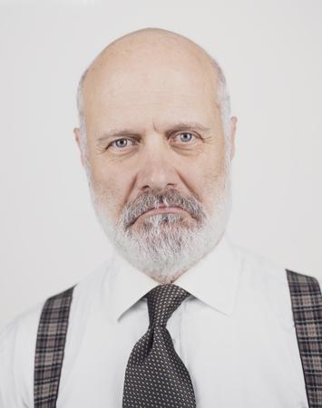 Disappointed sad senior man posing on white background, headshot Standard-Bild - 116683518