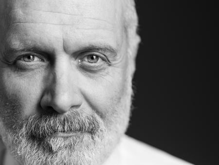 Black and white portrait of a confident mature man, close up Standard-Bild - 116681616