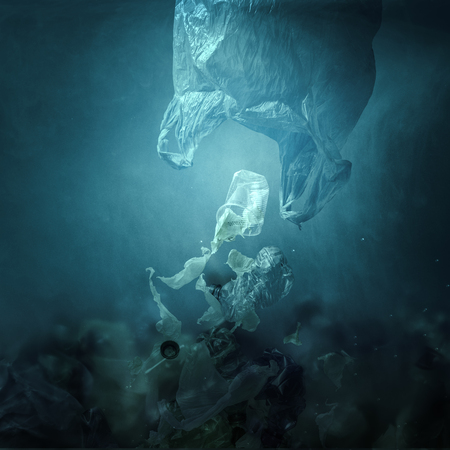 Plastic bag floating underwater and dispersing waste, ocean pollution and environmental damage concept