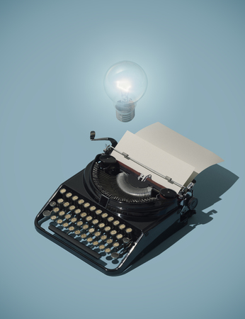 Creative writing and inspirational ideas: lit bulb over a vintage typewriter with blank sheet Stockfoto