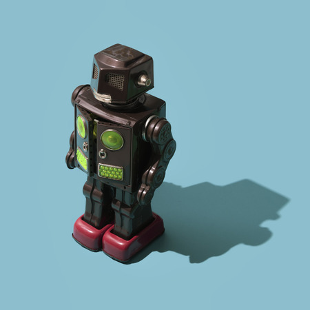 Funny vintage tin toy robot with mechanical arms, creative vintage toys concept