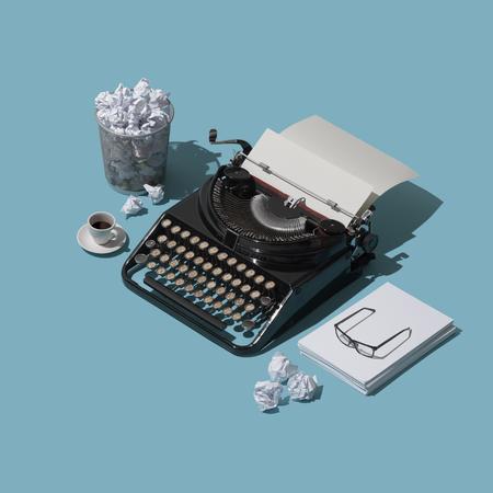 Strach albo pusta strona i brak inspiracji: stara maszyna do pisania z czystą kartką i mnóstwem pogniecionych papierowych kulek w koszu na śmieci