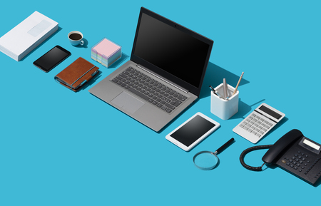 Contemporary corporate business desktop with laptop and isometric objects, management and technology concept