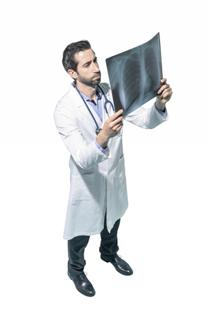 Professional radiologist checking a patient's radiography, white background