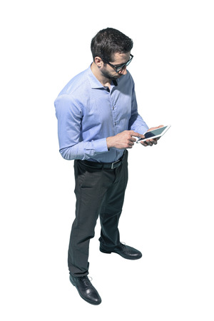 Man standing and using a smartphone on white background Standard-Bild - 124477649