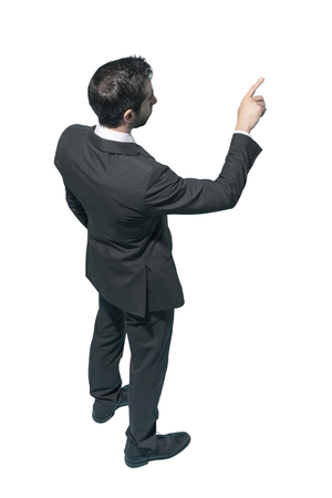 Corporate businessman pointing or touching on white background Standard-Bild - 124477661