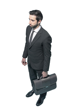 Businessman standing with briefcase on white background, business and finance concept Standard-Bild - 124477668