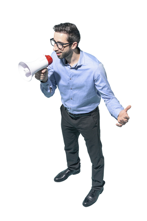 Confident man talking with a megaphone and giving a speech, marketing and communication concept, white background Standard-Bild - 124477669