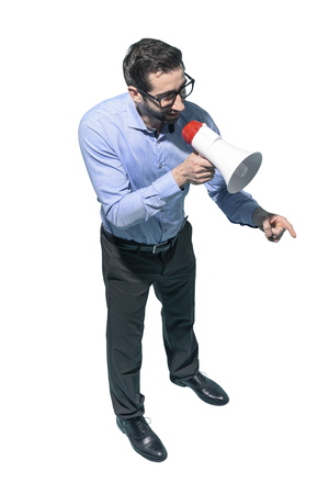 Confident man talking with a megaphone and giving a speech, marketing and communication concept, white background Standard-Bild - 124477670