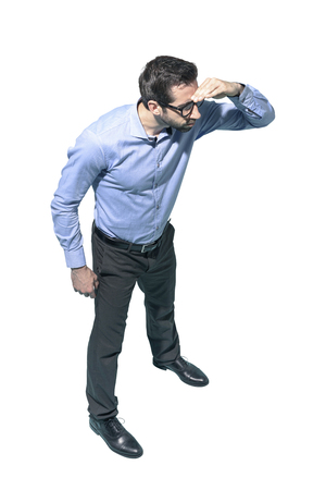 Young businessman bending and looking far away, white background Standard-Bild - 124477827