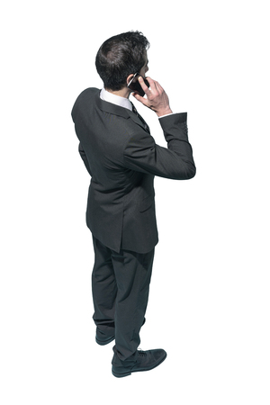 Corporate businessman using a smartphone on white background, business and communication concept Imagens