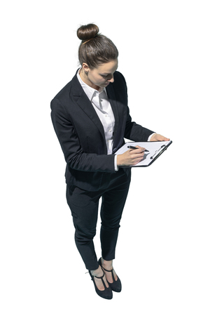 Corporate businesswoman checking a financial report on white background Standard-Bild - 124477839