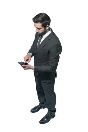 Corporate businessman using a smartphone on white background, business and communication concept Standard-Bild - 124477840