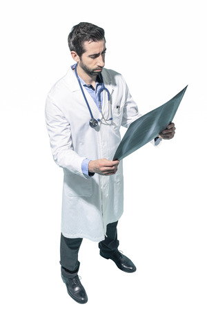 Professional radiologist checking a patient's radiography, white background Standard-Bild - 124477843