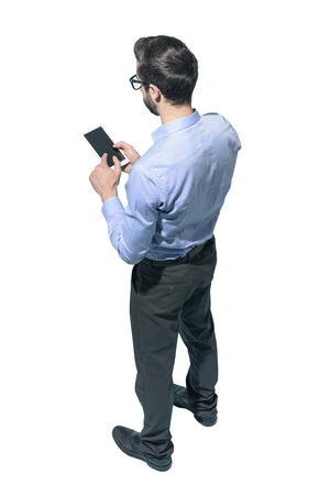 Man standing and using a smartphone on white background Standard-Bild - 124477845