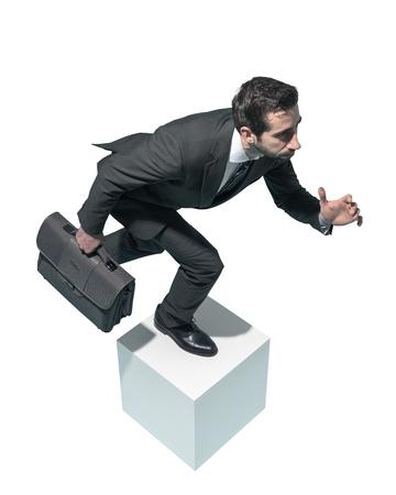 Efficient fast businessman running with his briefcase on white background Standard-Bild - 124477847