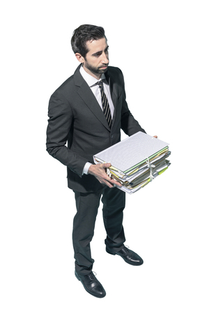 Corporate businessman standing and holding a pile of paperwork on white background Standard-Bild - 124477849