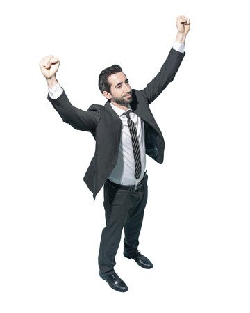 Cheerful winner businessman celebrating his success with fists raised on white background Standard-Bild - 124477850