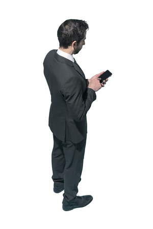 Corporate businessman using a smartphone on white background, business and communication concept Standard-Bild - 124477852