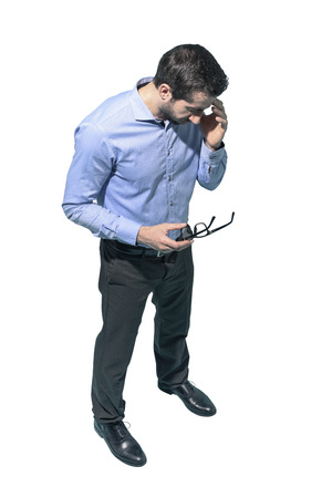 Tired stressed man with headache, he is touching his forehead, white background Standard-Bild - 124477854