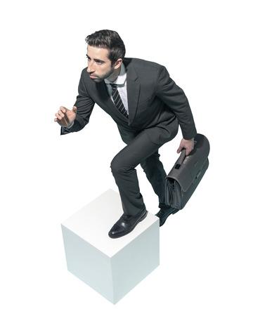 Efficient fast businessman running with his briefcase on white background Standard-Bild - 124477950