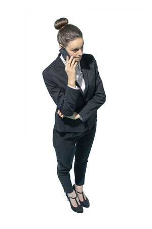 Professional corporate businesswoman using a smartphone on white background Standard-Bild - 124477955