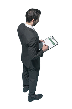 Corporate businessman writing a financial report on white background Standard-Bild - 124477956