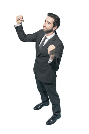 Cheerful winner businessman celebrating his success with fists raised on white background Standard-Bild - 124477959
