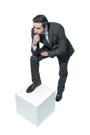 Confident businessman posing with hand on chin, white background Standard-Bild - 124478048