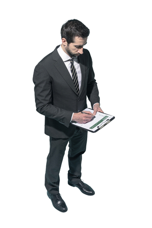Corporate businessman writing a financial report on white background Standard-Bild - 124478057