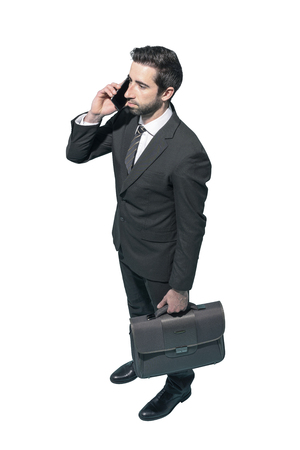 Corporate businessman using a smartphone on white background, business and communication concept Standard-Bild - 124478060