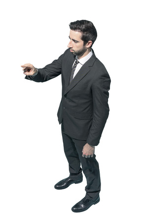 Corporate businessman pointing or touching on white background Standard-Bild - 124478260