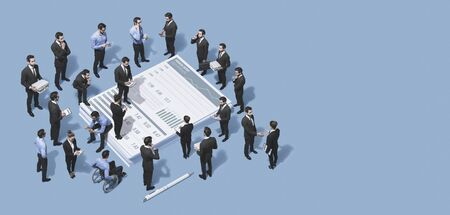 Mixed business team working together and analyzing a financial report, teamwork and cooperation concept, blank copy space