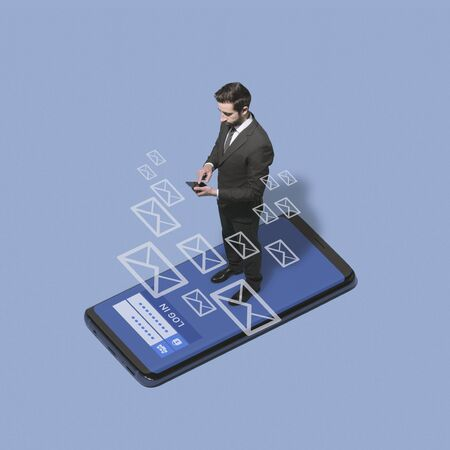 Business executive logging in into his phone and checking his messages, communication and technology concept