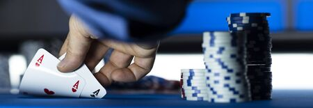 Hold 'em Texas poker tournament at casino: a player is holding two ace cards
