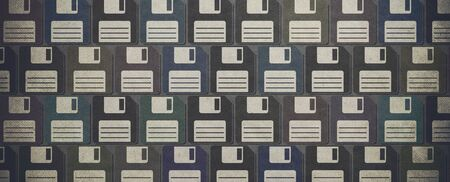Vintage floppy disks textured background: retro revival and technology