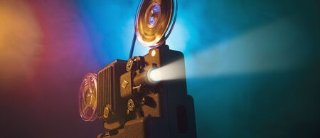 Vintage old fashioned projector in a dark room projecting a film, cinematography concept Reklamní fotografie