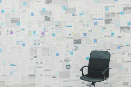 Office wall covered with financial reports, paperwork and sticky notes: business management concept
