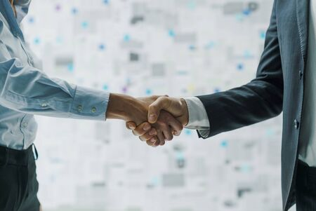Corporate business partners meeting and shaking hands, agreements and contracts concept Stock Photo