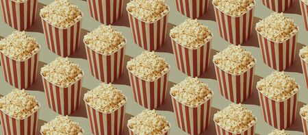 Cinema and movies entertainment background: repetition of popcorn boxes