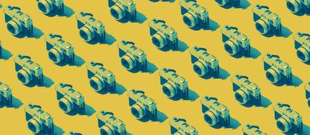 Photography background with repetition of identical cameras on yellow background