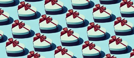 Gift boxes background with repetition of identical presents