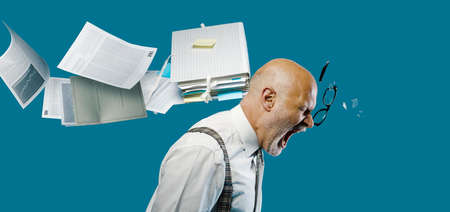 Flying paperwork hitting and hurting a businessman's head, unexpected payments and crisis concept